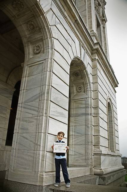 Aiden with his certificate posing just outside of the Capitol on the steps. Photo: Wonderlovely Photography