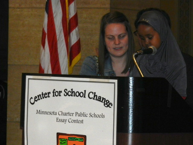 Sabrin Yusuf, 1st grader from Hennepin Elementary, speaks at the podium.