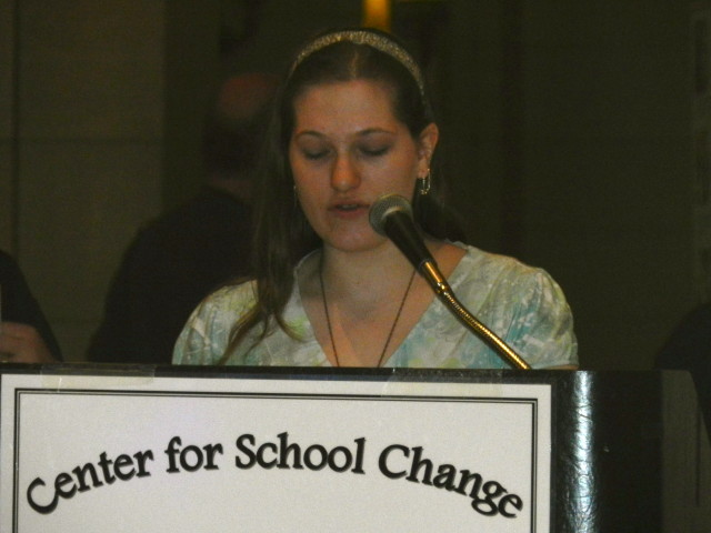 Emily Barta, 12th grader from Spectrum High School, reads her essay.
