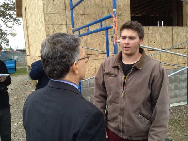 Forest Lake High School student  Mac Schwartz explains to Sen. Al Franken the value of a class that is teaching him to help build a real house.