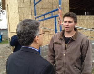 Forest Lake High School student Mac Schwartz, 17, talks with Sen. Al Franken Oct. 22, 2013, about the value of a course he's taking that's helping him understand how to build a house. (photo by Joe Nathan)