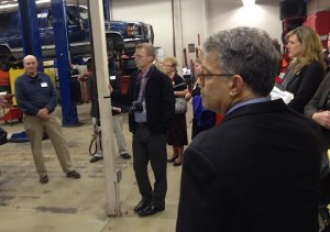 During his tour to see career and technical classes in action at Forest Lake High School on Oct. 22, 2013, Sen. Al Franken steps into the auto shop to hear about the auto repair class. (photo by Joe Nathan)