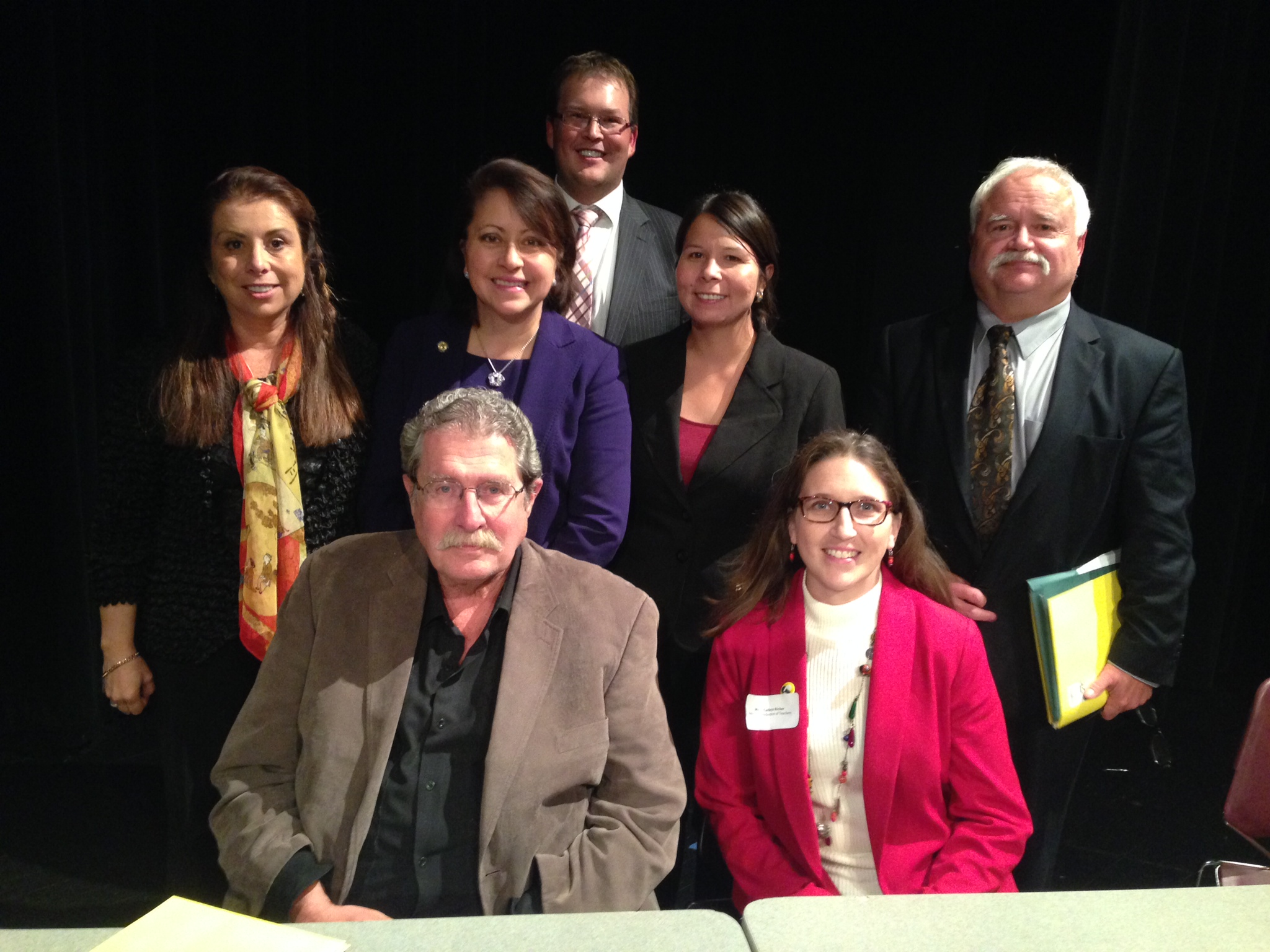 Front: Dr. David Beaulieu, Mary Cathryn Ricker 2nd Row: Supt. Valeria Silva, Sen. Patricia Torres Ray, Leslie Apple, Larry Anderson Back: Dennis Olson